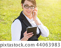 Young business woman with tablet and phone 44063983