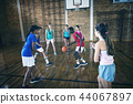 High school kids playing basketball in the court 44067897