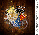 Pop-corn, movie tickets, clapperboard and other things in motion. 44068752