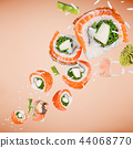 Pieces of delicious japanese sushi frozen in the air. 44068770
