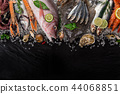 Fresh tasty seafood served on old wooden table. 44068851