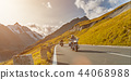 Motorcycle drivers riding in Alpine highway on famous Hochalpenstrasse, Austria, Europe. 44068988