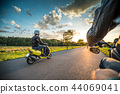 Motor biker riding on empty road with sunset light, concept of speed and touring in nature. 44069041
