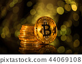 Bitcoin gold coin with defocused abstract background. Virtual cryptocurrency concept. 44069108