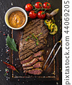 Delicious beef rump steak on wooden table 44069205
