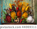 Various colorful spices on wooden table 44069311