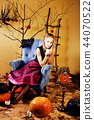 young pretty teenage girl in halloween holiday decorated interio 44070522