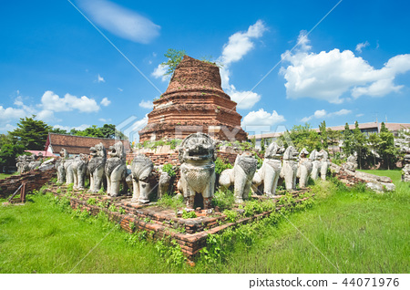 Ruined pagoda with surrounded by lion sculptures 44071976