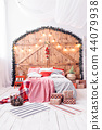 Xmas in morning bedroom. Double bed In christmas Interior on wood wall background 44079938