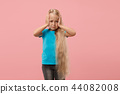 Girl having headache. Isolated over pink background. 44082008