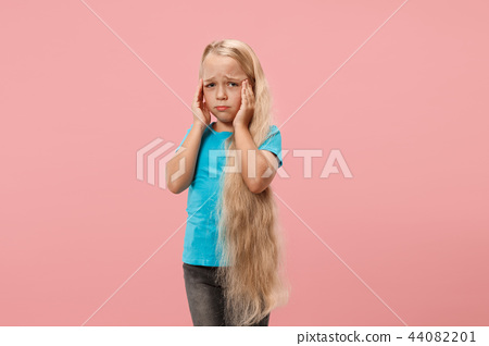 Girl having headache. Isolated over pink background. 44082201