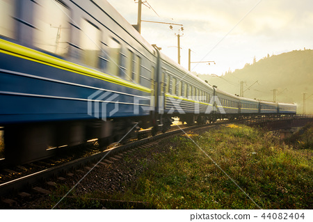 fast moving train through viaduct in mountains 44082404