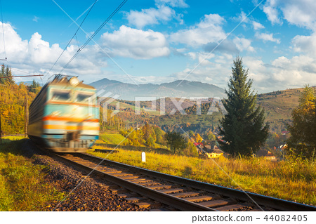 fast moving train in autumn mountains 44082405