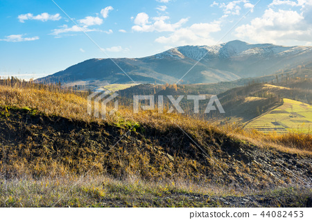 grassy hill in autumn mountains 44082453