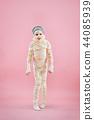 Studio image of a young teen girl man bandaged, 44085939