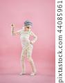 Studio image of a young teen girl man bandaged, 44085961
