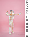 Studio image of a young teen girl man bandaged, 44085964