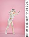 Studio image of a young teen girl man bandaged, 44085967