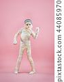 Studio image of a young teen girl man bandaged, 44085970