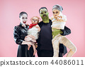 Halloween Family. Happy Father, Mother and Children Girls in Halloween Costume and Makeup 44086011