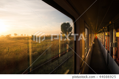 Beautiful sunrise on the vintage train 44086925