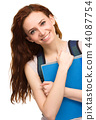 Young student girl is holding book 44087754