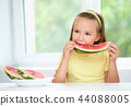 Cute little girl is eating watermelon 44088005