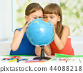 Little girls are examining globe 44088218