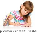 Little girl is drawing using pencils 44088366