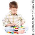 Little boy is playing with toys 44088746