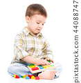 Little boy is playing with toys 44088747