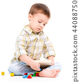 Little boy is playing with toys 44088750