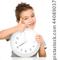 Boy is holding big clock 44089037