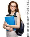 Young student girl is holding book 44089381