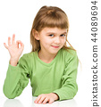 Happy little girl is showing OK sign 44089694
