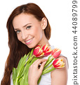 Young woman is holding bouquet of tulips 44089799