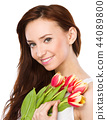 Young woman is holding bouquet of tulips 44089800