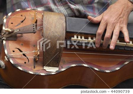 Playing a violin 44090739