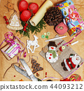 lot of stuff for handmade gifts, scissors, ribbon, paper with co 44093212