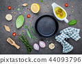 Cast iron skillet on dark stone background.  44093796