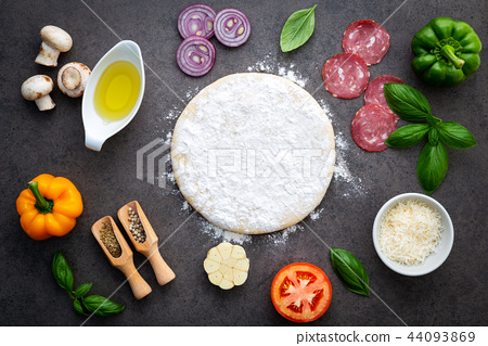 The ingredients for homemade pizza . 44093869