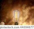 Vintage light bulb on dark background. 44094677