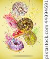 Tasty doughnuts in motion falling on pastel blue background. 44094691
