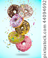 Tasty doughnuts in motion falling on pastel blue background. 44094692