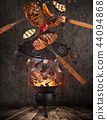 Kettle grill with hot briquettes, cast iron grate and tasty beef steaks flying in the air. 44094868
