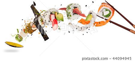 Pieces of delicious japanese sushi frozen in the air. 44094945