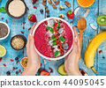 Smoothie bowl with fresh berries, nuts, seeds, fruit and vegetables. 44095045