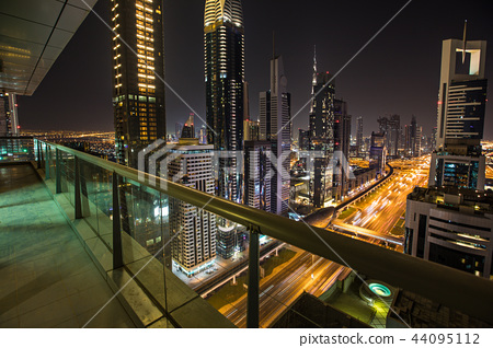 Dubai skyline during night with amazing city center lights and heavy road traffic,UAE. 44095112