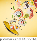 Pieces of delicious japanese sushi frozen in the air. 44095164