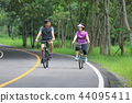 Middle aged couple relaxing exercise with bicycle 44095411